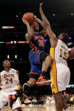 New York Knicks v Los Angeles Lakers, Los Angeles, CA - January 09: Wilson Chandler and Andrew Bynu Photographic Print by Stephen Dunn
