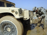 Staff Sergeant Unties a Rope to Tow a Humvee out of the Mud During a Convoy Patrol Photographic Print by  Stocktrek Images