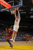 Cleveland Cavaliers  v Golden State Warriors, Oakland, CA - January 7: David Lee Photographic Print by Rocky Widner