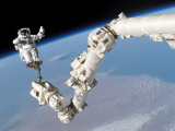 Astronaut Anchored to a Foot Restraint on the International Space Station's Canadarm2 Photographic Print by  Stocktrek Images