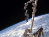 Nchored to the International Space Station's Canadarm2 Foot Restraint Photographic Print by  Stocktrek Images
