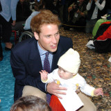 Prince William with 1 year old Kennard Nanau on a visit to the Auckland childrens Hospital, New Zea Photographic Print