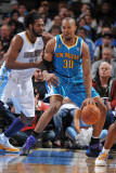 New Orleans Hornets v Denver Nuggets, Denver - January 9: David West and Nene Fotografie-Druck von Garrett Ellwood
