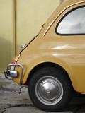 Yellow Fiat 500 Parked Against Wall, Gallipoli Fotografiskt tryck av David Borland