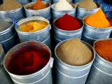Colourful Piles of Spices on Display in Spice Souk Photographic Print by Doug McKinlay