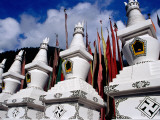 Tibetan Stupas at the Entrance to Shuzheng Village Photographic Print by Krzysztof Dydynski