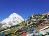 Prayer Flags on Mountain Pass, Snow-Capped Qugongla in Distance, Between Lhasa and Shigatse Photographic Print by Keren Su