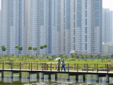 People on Walking Trail Through the Hong Kong Wetland Park, Tin Shui Wai, New Territories Photographic Print by Michael Coyne
