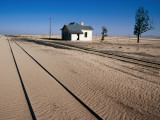 Abandoned Railway Station in Namib Desert Between Aus and Luderitz Photographic Print by Karl Lehmann