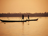 Two Men Poling Canoes on Vembanad Lake Photographic Print by Craig Pershouse