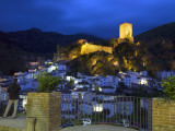 Tourist Taking Picture from Pintor Zabaleta Balcony of La Yedra Castle Illuminated at Night Photographic Print by Diego Lezama