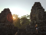 Female Tourist Photographer at Bayon Temple at Sunset Photographic Print by Felix Hug