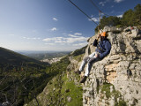 Man Suspended on Flying Fox Watching over Village of Cazorla Photographic Print by Diego Lezama