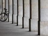 Bicycle Wheel in Arcade Photographic Print by David Borland