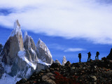 Hikers on a Ridge Dwarfed by Cerro Torre Photographic Print by Gareth McCormack