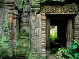 Lichen Covered Carvings Lead to a Doorway at Ta Proh Photographic Print by Glenn Beanland