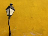 Yellow Coloured Wall and Street Light Photographic Print by Doug McKinlay
