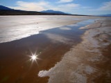 Temporary Waterway in Floor of Death Valley in Winter, with Reflection of Sun in Water Photographic Print by Feargus Cooney