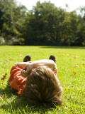 Child Relaxing in Royal Botanic Gardens Photographic Print by Greg Elms