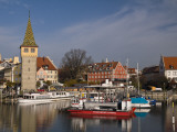 Small Harbour with Mang Tower (Left) on Bodensee (Lake Constance) Fotografie-Druck von Glenn Van Der Knijff
