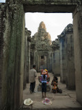 Local Family Paying Respects at Bayon Temple Photographic Print by Felix Hug