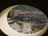 Town Square and Nearby Hills Through Oval Hotel Window Photographic Print by Dennis Johnson