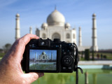 Tourist Taking Picture of Taj Mahal Photographic Print by Huw Jones