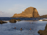 People in Natural Swimming Rock Pools and Ilheu Mole Island Photographic Print by Holger Leue