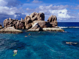Snorkellers Near Granite Outcrops Photographic Print by Jean-Bernard Carillet