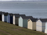 Colourful Beach Huts at the Seaside in Whitstable Photographic Print by Doug McKinlay
