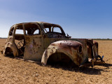Old Abandoned Car in Fallow Field Photographic Print by Greg Elms