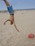 Boys Jumping at Las Arenas Beach Reproduction photographique par Krzysztof Dydynski
