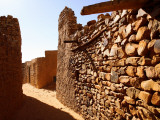 Narrow Alleyway Through Ruins of Desert Town Photographic Print by Feargus Cooney