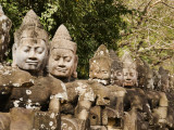Giant Statues Lining Road at Entrance to South Gate of Angkor Thom Photographic Print by Christopher Groenhout