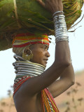 Portrait of a Bondo Woman Carrying a Load on Her Head Walking to Market, Early Morning Photographic Print by Keren Su