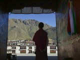 Monk Silhouetted in Doorway, Tashilhunpo Monastery Photographic Print by Keren Su