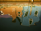 Reflections in a Burano Cana Photographic Print by Dennis Walton
