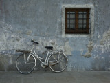Bicycle Against Chipped Wall Photographic Print by Guylain Doyle