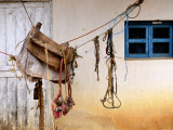 Home-Made Saddle Hanging Outside on Ropes Photographic Print by Douglas Steakley