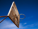 Basketball Net Against Blue Sky Photographic Print by Kimberley Coole