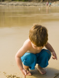 Young Boy Drawing in Sand at Little Cove Photographic Print by Greg Elms