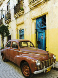 Vintage Car Parked Outside House in Vieja District Photographic Print by Christian Aslund