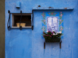 Blue Wall with Window and Religious Painting Photographic Print by Dennis Walton