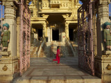 Child Running Past Entrance to Jain Temple Photographic Print by Johnny Haglund