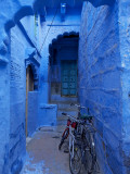 Bicycles Parked in Blue-Painted Laneway Photographic Print by Johnny Haglund