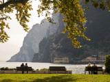 Tourists at a Park Beside Lago Di Garda (Lake Garda) Fotografie-Druck von Glenn Van Der Knijff