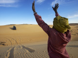 Tuareg Man Guiding 4Wd Car Through Soft Sand Dune Photographic Print by Johnny Haglund