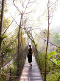 Woman Crossing Bridge Between Lobby and Accomodation Area at Four Seasons Tented Camp Photographic Print by Felix Hug