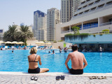 Couple Sitting by a Swimming Pool in the 40 Degree Heat Photographic Print by Christian Aslund