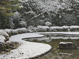 Snow Covered Trees Near Pond in Garden of Heian Shrine Photographic Print by Frank Carter